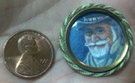 Personal token of affection, a portrait miniature painting in an enameled pin brooch frame.